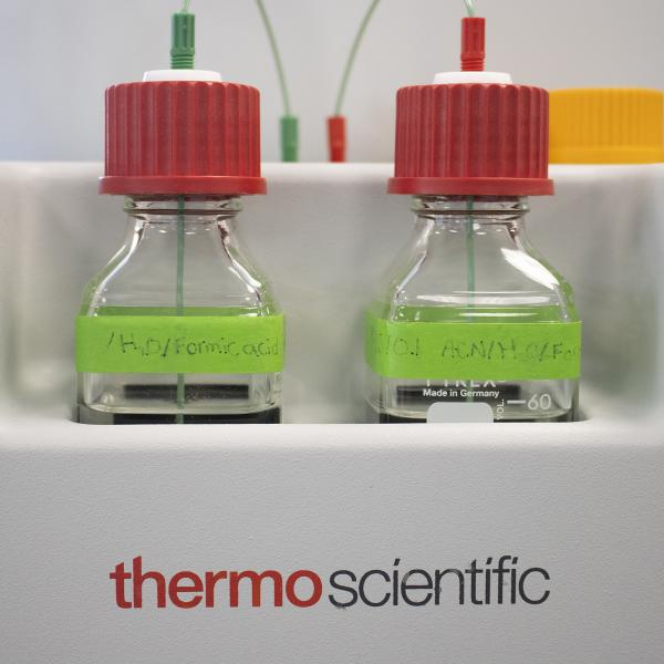 Two bottles in the Thermo Fisher Scientific Orbitrap Mass Spectrometer System