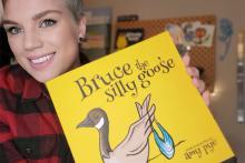 VIU alum Amy Pye holding her new children's book