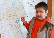 Terrence Good with his project at Shq'apthut, VIU's Aboriginal Gathering Place