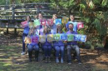 Members of MABRRI hold sustainable Development Goal icons.