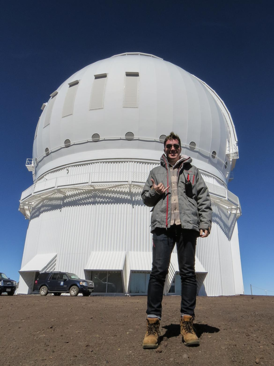 Cam Wipper in front of the Canada-France-Hawaii Telescope
