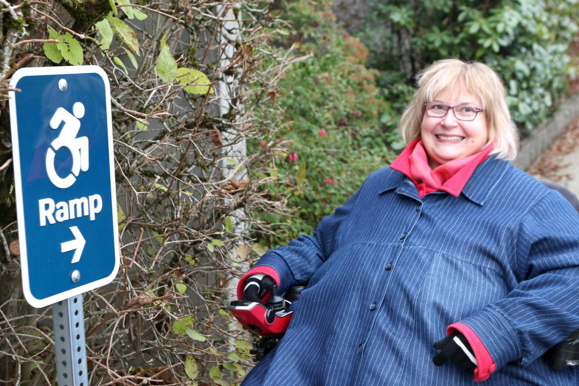 Dr. Linda Derksen with a ramp sign