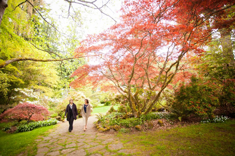 Two women walking a trail at Milner Gardens