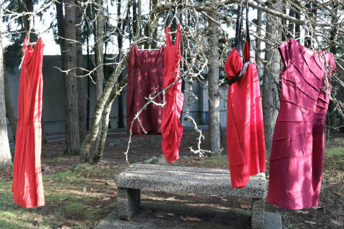 Red Dresses hang on a tree branches