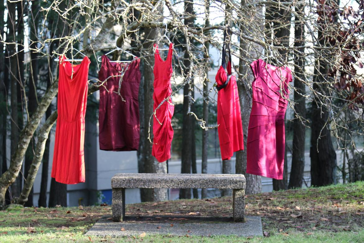 Red Dresses hang on a tree branch