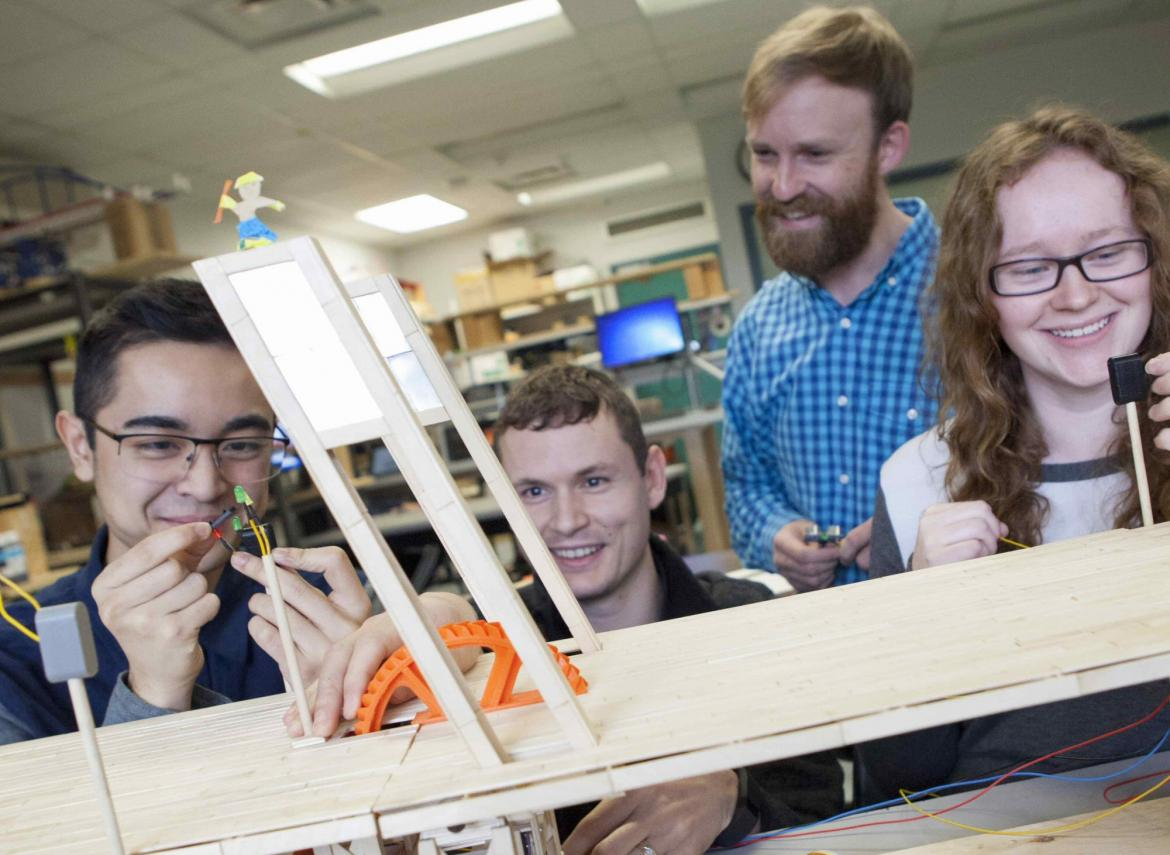: Vancouver Island University (VIU) students Wilson Nguyen, from left, Wesley Dunn, Allan Stenlund and Jennifer White work on their engineering design during last year's competition.