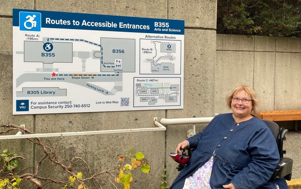Dr. Linda Derksen with wayfinding signage